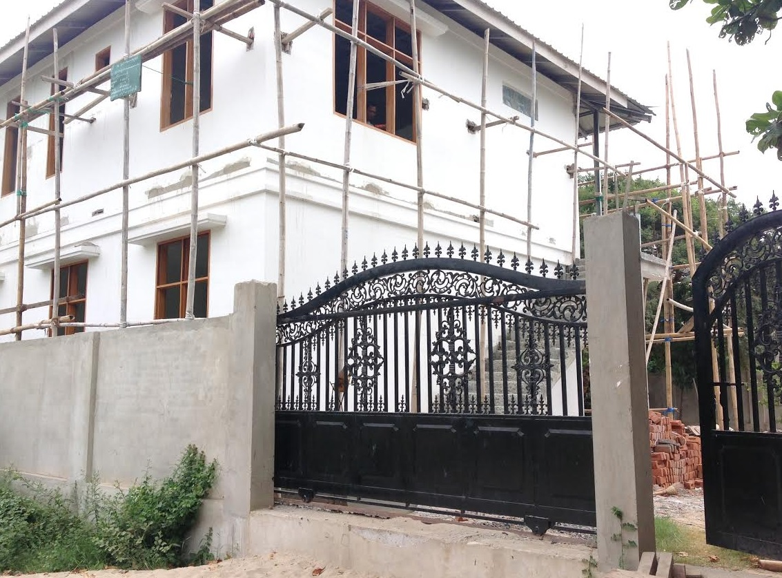 Front gates and the orphanage nearing completion